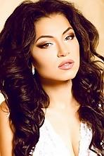 Ukrainian girl Olga,21 years old with hazel eyes and dark brown hair.