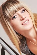 Ukrainian girl Irina,44 years old with grey eyes and blonde hair.