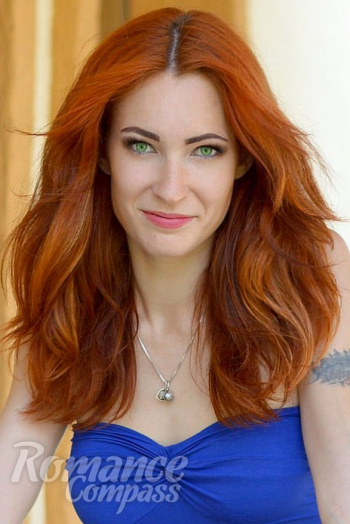 Ukrainian girl Valeria,27 years old with green eyes and red hair.