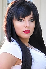 Ukrainian girl Alena,19 years old with green eyes and black hair.