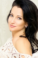 Ukrainian girl Angela,43 years old with blue eyes and black hair.