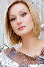 Ukrainian girl Elena,35 years old with green eyes and blonde hair.