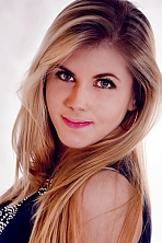 Ukrainian girl Olya,20 years old with green eyes and light brown hair.