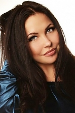 Ukrainian girl Alina,25 years old with green eyes and black hair.