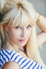Ukrainian girl Ella,45 years old with blue eyes and blonde hair.