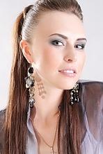 Ukrainian girl Alexandra,31 years old with grey eyes and dark brown hair.