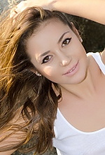 Ukrainian girl Anna,24 years old with brown eyes and dark brown hair.