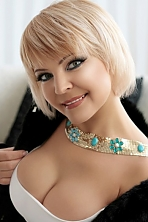 Ukrainian girl Natalia,48 years old with blue eyes and blonde hair.