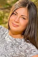 Ukrainian girl Irina,22 years old with brown eyes and black hair.