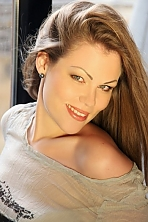 Ukrainian girl Lidia,30 years old with grey eyes and blonde hair.