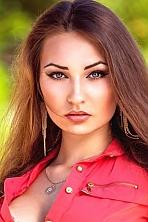 Ukrainian girl Viktoriya,18 years old with blue eyes and light brown hair.