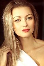 Ukrainian girl Viktoriya,22 years old with green eyes and blonde hair.