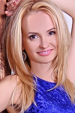 Ukrainian girl Tatyana 	,33 years old with brown eyes and blonde hair.