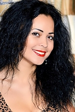 Ukrainian girl Valentina,30 years old with brown eyes and black hair.
