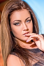 Ukrainian girl Maria,21 years old with blue eyes and dark brown hair.