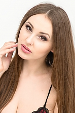 Ukrainian girl Alla,20 years old with brown eyes and light brown hair.