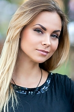 Ukrainian girl Sasha,31 years old with blue eyes and blonde hair.