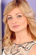 Ukrainian girl Anna,31 years old with grey eyes and blonde hair.