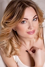 Ukrainian girl Daria,25 years old with blue eyes and light brown hair.