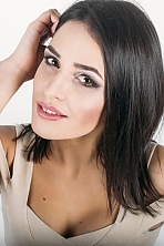 Ukrainian girl Anastasia,21 years old with hazel eyes and dark brown hair.