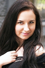 Ukrainian girl Larisa,24 years old with green eyes and black hair.