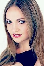 Ukrainian girl Olga,21 years old with blue eyes and light brown hair.