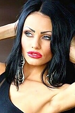Ukrainian girl Inna,23 years old with blue eyes and black hair.