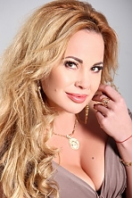 Ukrainian girl Natalia	,40 years old with green eyes and blonde hair.