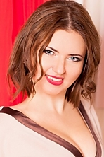 Ukrainian girl Marina,32 years old with blue eyes and light brown hair.