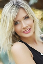 Ukrainian girl Anastasia,23 years old with brown eyes and blonde hair.