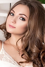 Ukrainian girl Elena,20 years old with blue eyes and light brown hair.