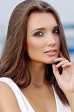 Ukrainian girl Roxolana,21 years old with green eyes and dark brown hair.
