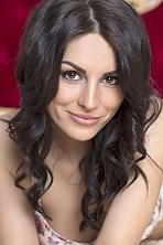 Ukrainian girl Irada,25 years old with brown eyes and dark brown hair.