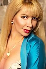 Ukrainian girl Viktoria,49 years old with hazel eyes and blonde hair.
