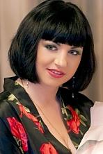 Ukrainian girl Lesya,31 years old with green eyes and dark brown hair.