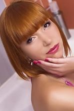 Ukrainian girl Yanina,29 years old with grey eyes and red hair.