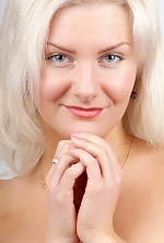 Russian girl Irina,32 years old with blue eyes and blonde hair.