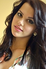 Ukrainian girl Tatiana,21 years old with green eyes and black hair.