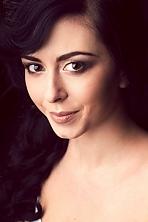 Ukrainian girl Olena,22 years old with brown eyes and black hair.