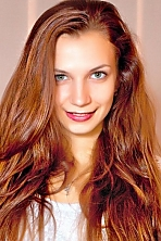 Ukrainian girl Viktoria,21 years old with green eyes and dark brown hair.