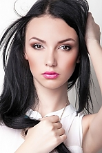 Ukrainian girl Karina,22 years old with green eyes and black hair.