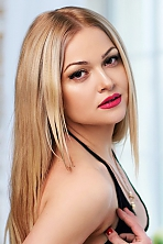 Ukrainian girl Natalia,32 years old with brown eyes and blonde hair.