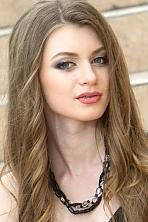 Ukrainian girl Alexsandra,23 years old with blue eyes and light brown hair.