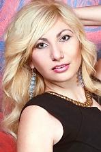 Ukrainian girl Nataliya,31 years old with brown eyes and blonde hair.