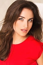 Ukrainian girl Maria,19 years old with grey eyes and dark brown hair.