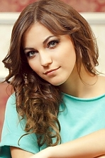 Ukrainian girl Marta,19 years old with green eyes and dark brown hair.