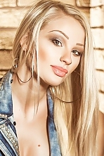 Ukrainian girl Ekaterina,25 years old with green eyes and blonde hair.