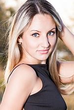 Ukrainian girl Anastasia,22 years old with grey eyes and blonde hair.
