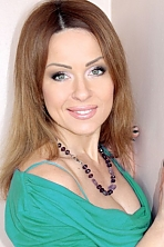 Ukrainian girl Natalia,38 years old with green eyes and light brown hair.