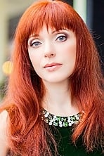 Ukrainian girl Alla,43 years old with blue eyes and red hair.